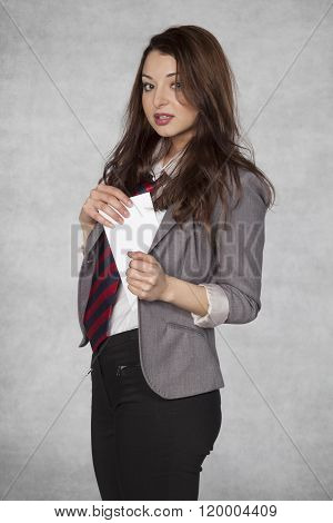 Businesswoman Hiding Envelope