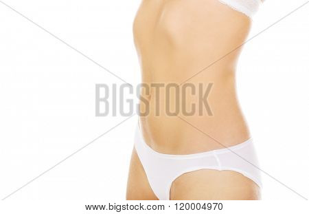 Body of slim young woman in white underwear