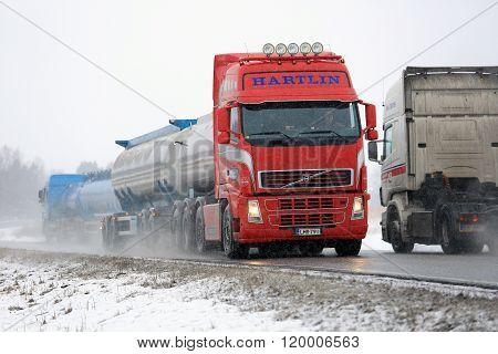 Busy Truck Traffic In Snowfall