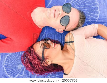 Happy Couple Lying Down - Top View Of Happy Hipster Lovers Having Fun Together  - Youth Concept With