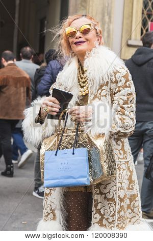 MILAN ITALY - FEBRUARY 25: Fashionable woman poses outside Luisa Beccaria fashion show building for Milan Women's Fashion Week on FEBRUARY 25 2016 in Milan.