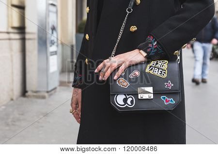 MILAN, ITALY - FEBRUARY 25, 2016: Detail of bag outside Luisa Beccaria fashion show building during Milan Women's Fashion Week