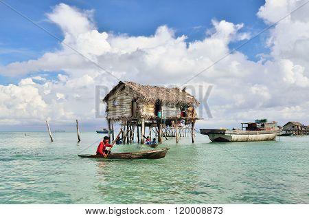 Bajau Laut on a boat