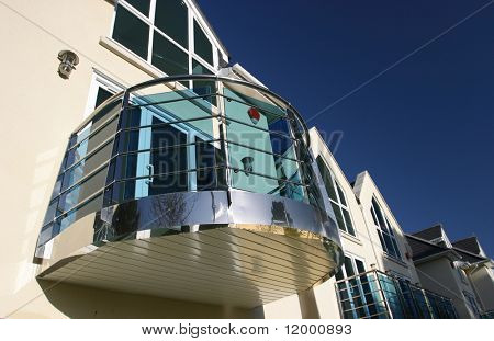 Curved Chrome Balcony on Modern House