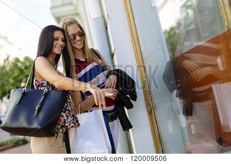 Beautiful young women shopping spree on street