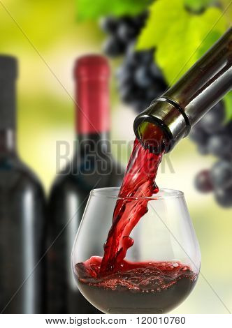 Image Bottle And Glass Of Red Wine Close-up