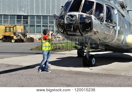 Spotting Fan Takes A Picture Of The Helicopter  At The Parking  In Pulkovo Airport