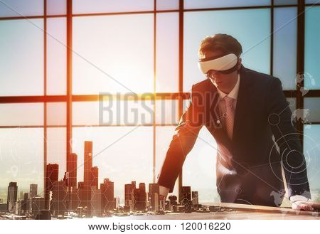 businessman developing a project using virtual reality goggles. the concept of technologies of the future