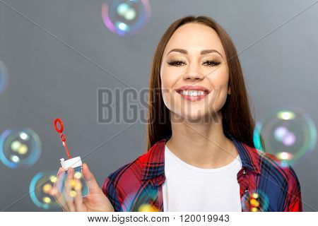 Nice girl blowing soapbubbles