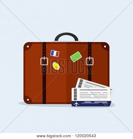 Transportation and travel. Suitcase with funky stickers and airplane tickets on blue background. Vac