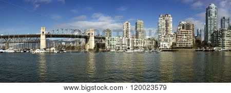 Panorama of Burrard bridge and buildings in Vancouver by a nice sunny day