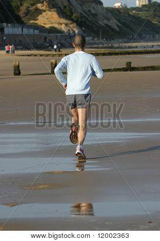Male Jogger on Beach