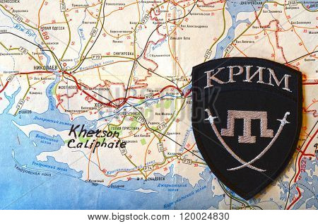Kiev,Ukraine.FEB 20 ILLUSTRATIVE EDITORIAL.Chevron of Islamic extremist formation Crimea.Background map of Kherson Caliphate.At February 20,2016 in Kiev, Ukraine
