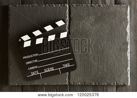Movie production clapper board over slate background