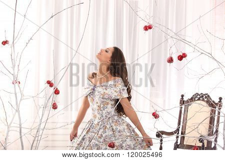 Girl On A Vintage Dress Possing With Stick Of Apple