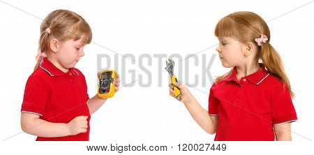 The girl holds in hand a digital multimeter and wrench