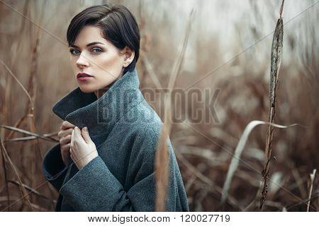 Beautiful Girl Outdoors In Autumn