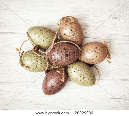 Beautiful Easter Eggs On The Wooden Background, Symbol Of Springtime