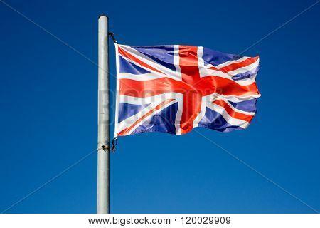 The British Flag Waving In The Wind, Uk Or United Kingdom Flag