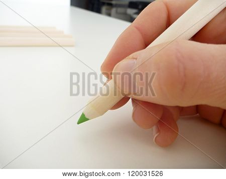 Green Pencil In A Hand Writing