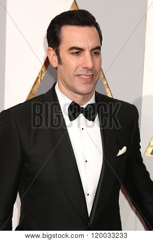 LOS ANGELES - FEB 28:  Sacha Baron Cohen, Isla Fisher at the 88th Annual Academy Awards - Arrivals at the Dolby Theater on February 28, 2016 in Los Angeles, CA