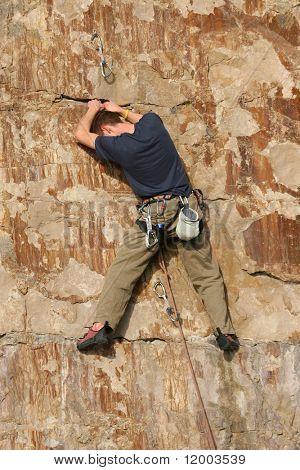 Rock climber assessing options