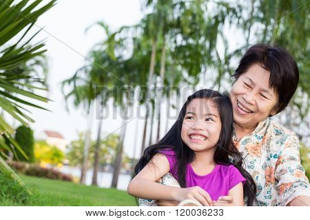 Happy Asian Grandma And Grandchild Smiling