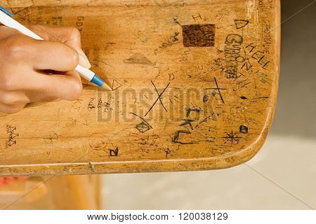 Student drawing on desk