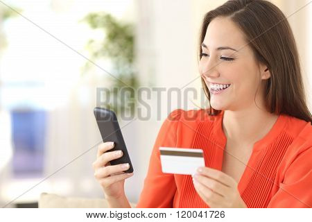 Lady Buying With Credit Card And Smart Phone