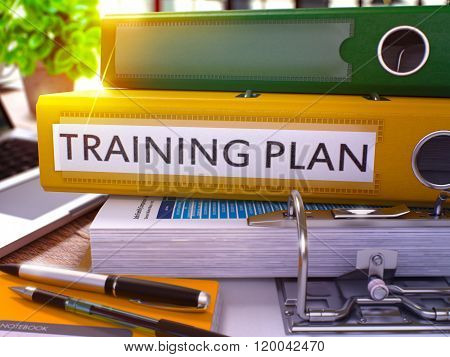 Yellow Office Folder with Inscription Training Plan.