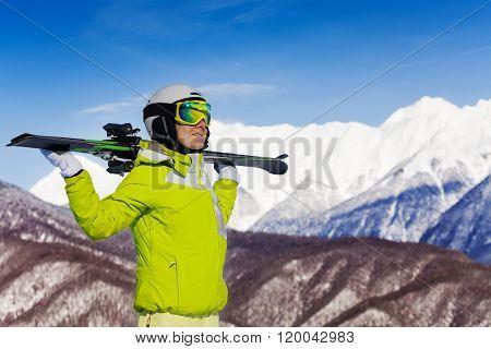 Woman with ski on shoulders enjoy mountain view