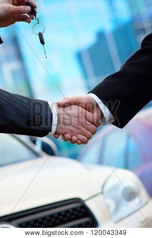 Handshake in auto show or salon