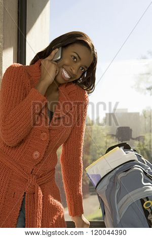 Female student talking on a cellular phone