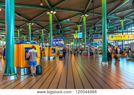 AMSTERDAM, NETHERLANDS - JULY 07, 2015: Schiphol airport interior - opened on September 16, 1916 as military airbase now it is main international airport of Netherlands and fifth busiest in Europe.