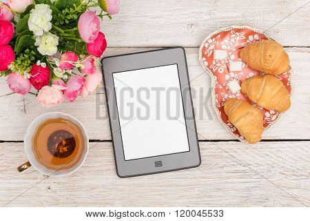 Morning tea, croissants while reading ebook