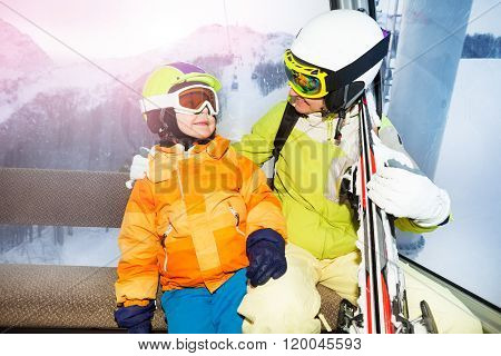 Mom and son talk in cable car cabin