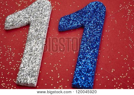 Number Eleven Silver Blue Color Over A Red Background. Anniversary