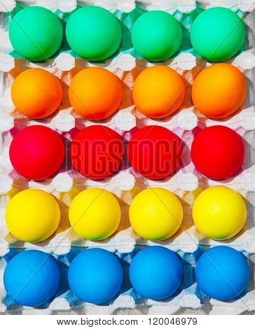 Variety of colorful Easter eggs in box, festive abstract background, traditional food for spring holiday