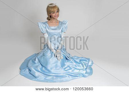 Fairytale Princess. Portrait Of Happy Woman In Crown