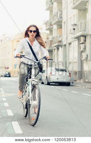 Office Worker Using E-bike To Commute