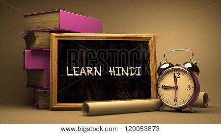 Hand Drawn Learn Hindi Concept on Chalkboard.