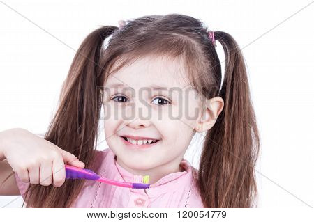 Child decayed teeth with toothbrush on white background
