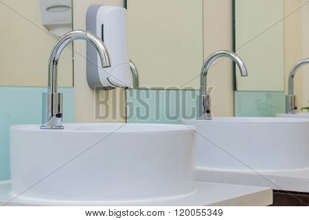 White Basins In Bathroom Interior With Granitic Tiles