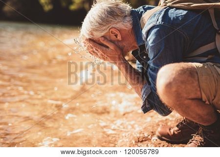 Mature Man Getting Fresh During A Hike