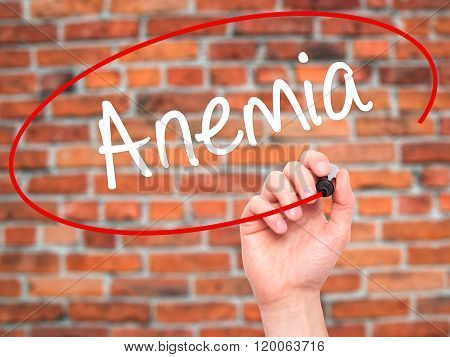 Man Hand Writing Anemia With Black Marker On Visual Screen.