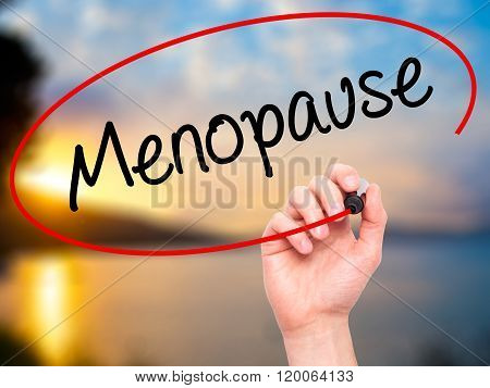 Man Hand Writing Menopause With Black Marker On Visual Screen.