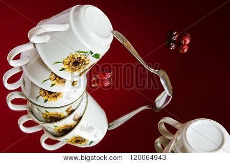 Surreal still life with a flying set of porcelain cups