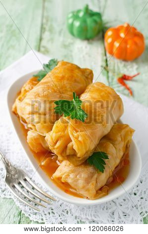 Stuffed Cabbage Rolls With Rice And Meat On A White Plate