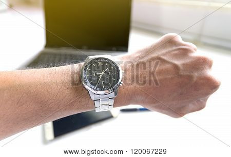 Businessman Looking A Watch.