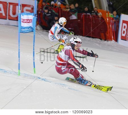 Skier Nina Loeseth And Competitor Skiing At A Slalom Event